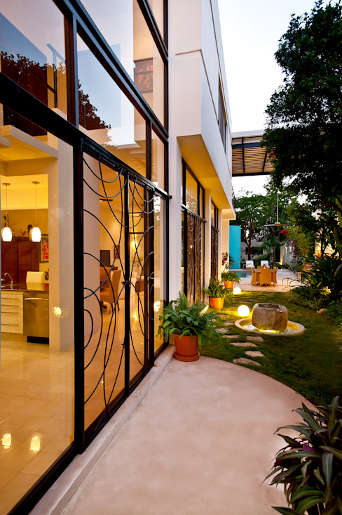 Casas de estilo  por Taller Estilo Arquitectura,