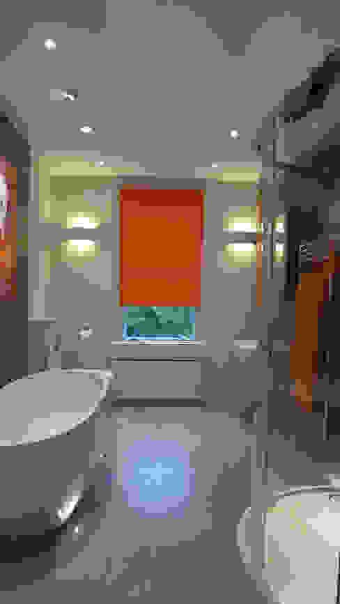 Bathrooms and En-Suites Style Within Baños de estilo moderno