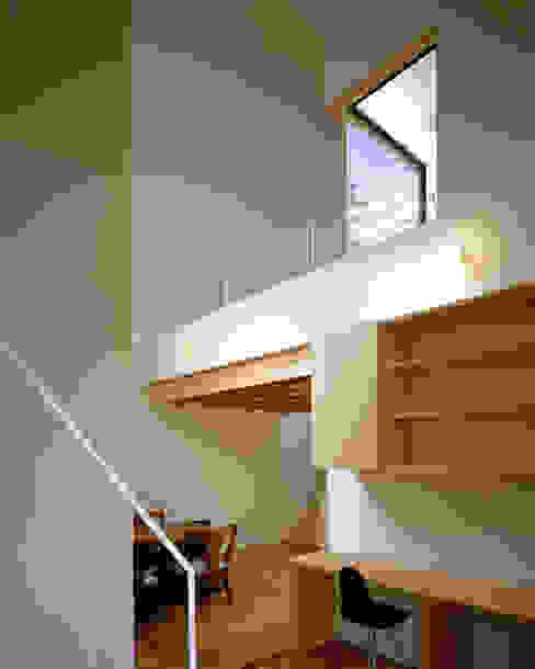 習志野台の家: シミズアトリエ 一級建築士事務所が手掛けたダイニングです。,ミニマル 木 木目調