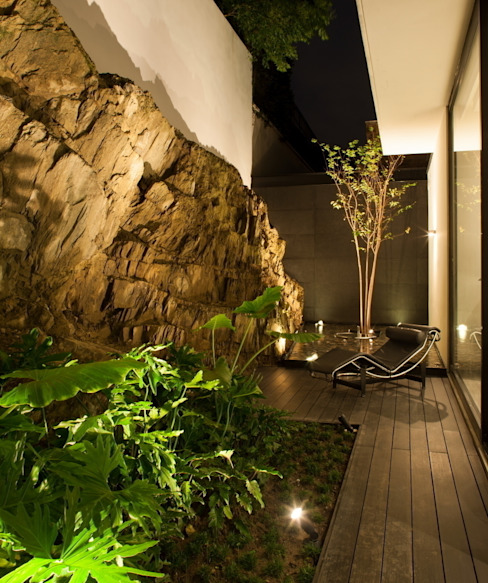 Modern garden by GLR Arquitectos Modern