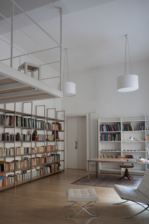 Salones de estilo minimalista de 3C+M architettura Minimalista