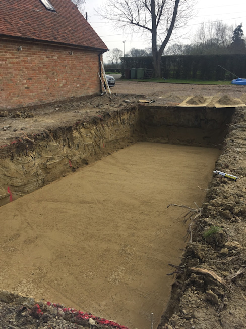 Hole Dug for the Pool: modern  by XL Pools Ltd, Modern