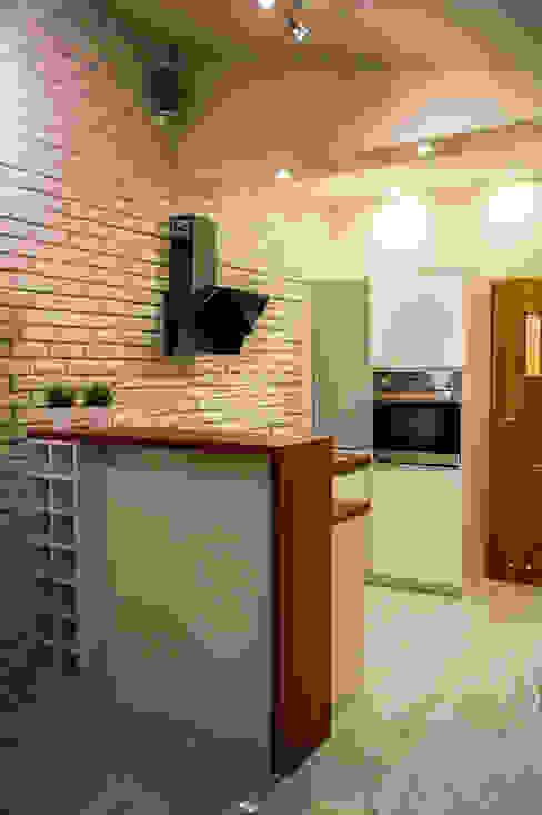 Kawalerka Kęty: styl , w kategorii Kuchnia zaprojektowany przez Studio Mirago,Nowoczesny