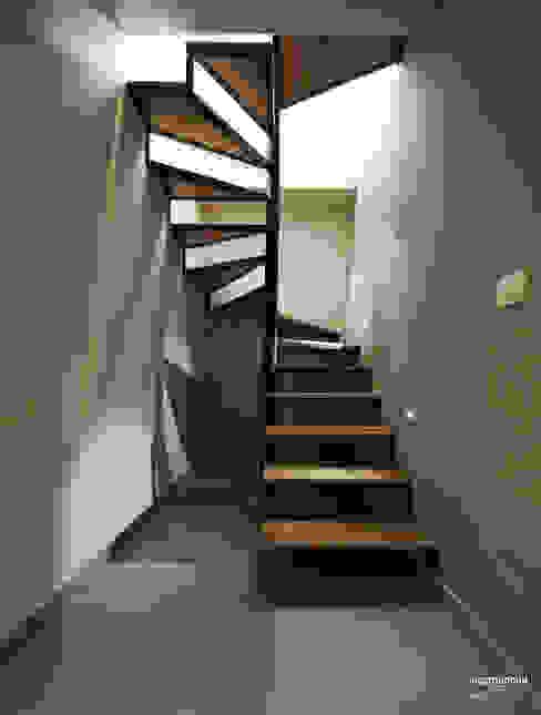Pasillos, vestíbulos y escaleras de estilo moderno de Luca Mancini | Architetto Moderno