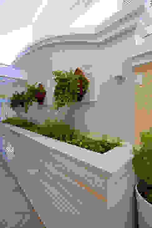 Jardines de estilo  por Arquiteto Aquiles Nícolas Kílaris, Moderno