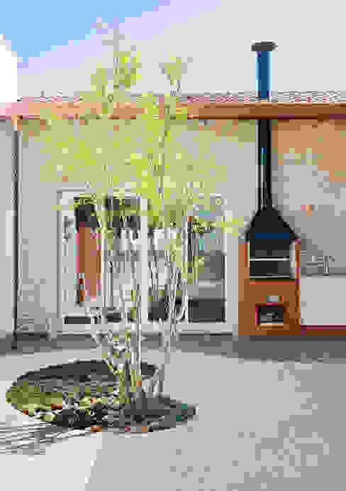 NOMA ESTUDIO Balcones y terrazas de estilo rural
