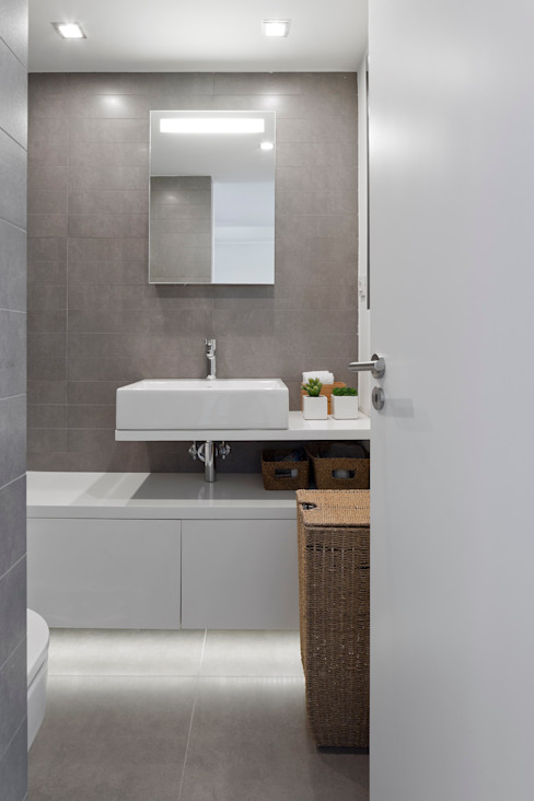 Baños de estilo  por RRJ Arquitectos