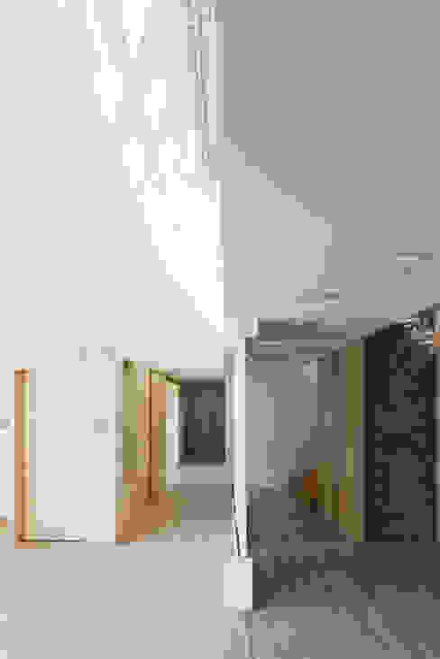 E+ Green Home: UnSangDong Architects의  복도 & 현관