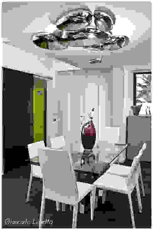 Zona pranzo Sala da pranzo moderna di Ignazio Buscio Architetto Moderno