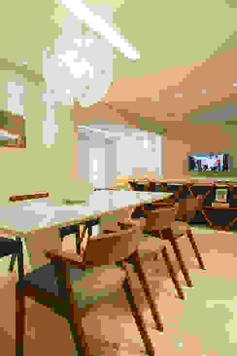 Apartamento Caravelas Salas de jantar ecléticas por homify Eclético