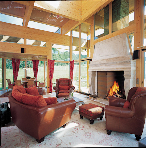 Rustic style living room by ELK Fertighaus GmbH Rustic