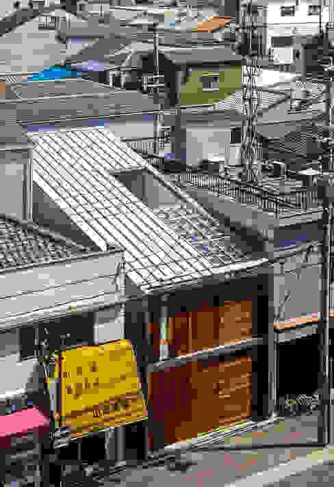 Casas de estilo ecléctico de 緒方幸樹建築設計事務所 Ecléctico