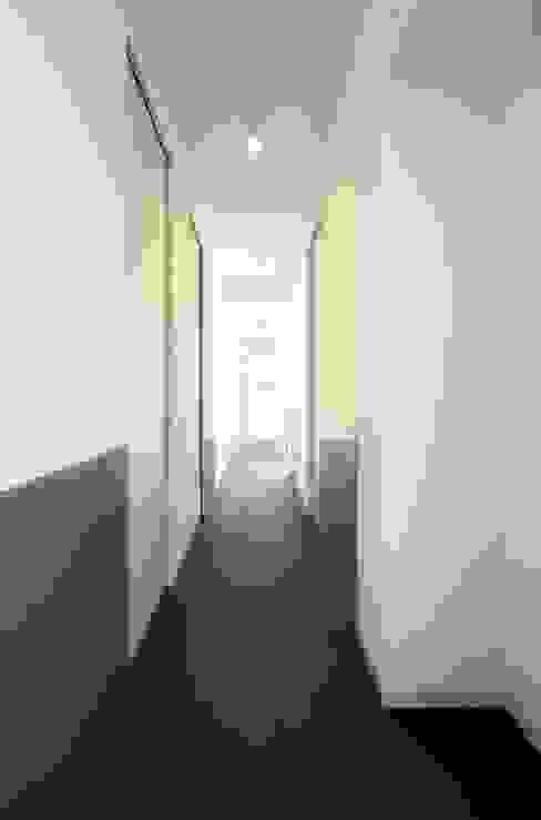 CAS/AL/PALOCCO [2012] Ingresso, Corridoio & Scale in stile moderno di na3 - studio di architettura Moderno Vetro
