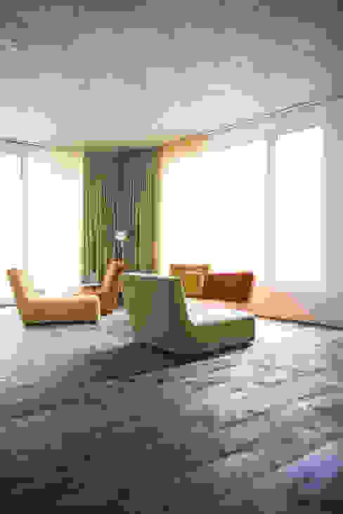Salas / recibidores de estilo  por idA buehrer wuest architekten sia ag, Moderno