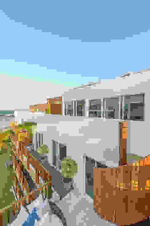 Casas tropicais por homify Tropical