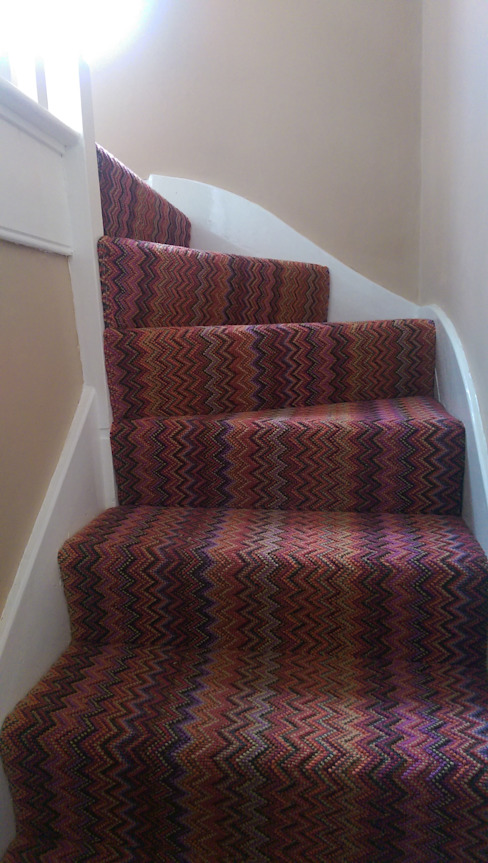 Fabulous Stairs Eclectic style corridor, hallway & stairs by Wools of New Zealand Eclectic Wool Orange