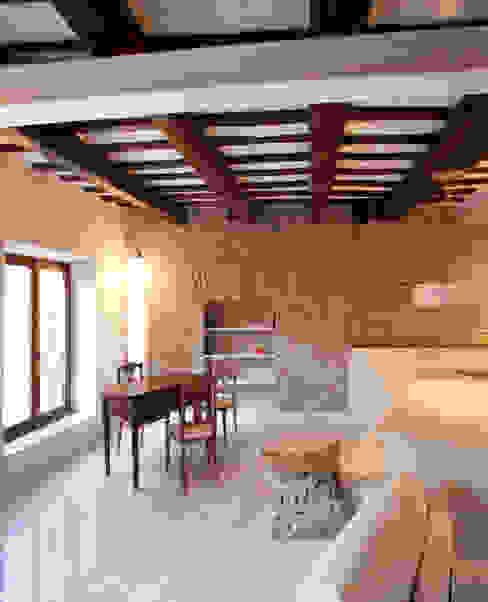 Casas de estilo ecléctico de Archifacturing Ecléctico