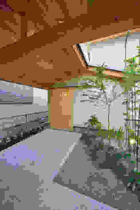 Jardines de estilo ecléctico de 五藤久佳デザインオフィス有限会社 Ecléctico