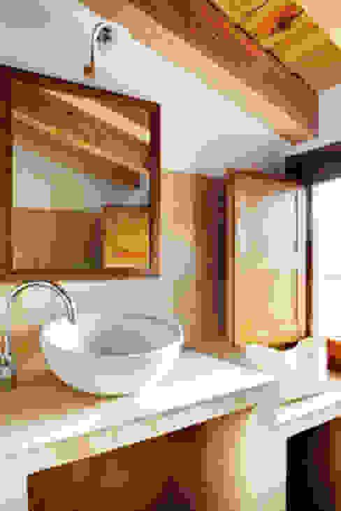 Casas EPPD Baños de estilo rural de Jacobo Lladó Estudio de Arquitectura Rural