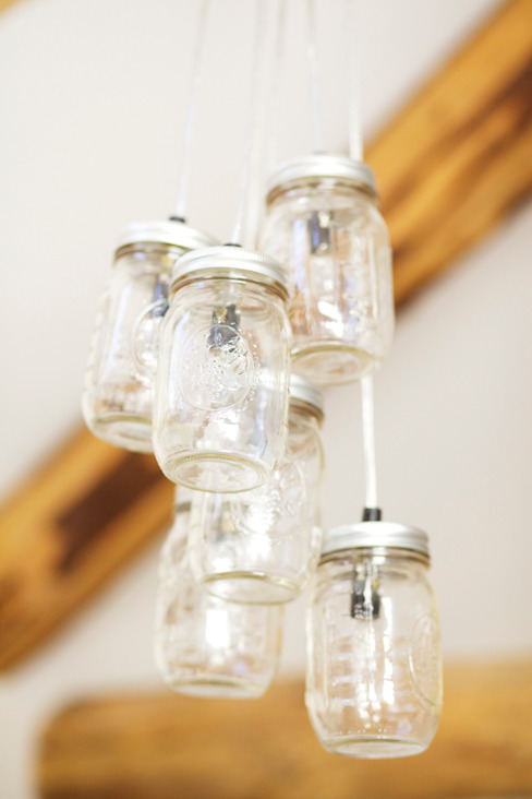 Mason jar collection chandeliers Eclectic style bedroom by Woodford Architecture and Interiors Eclectic Aluminium/Zinc