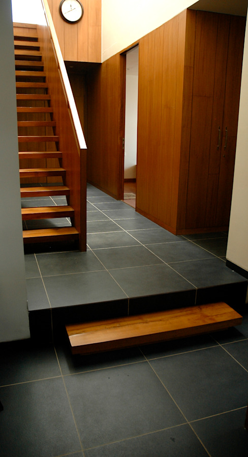 Asian style corridor, hallway & stairs by KIRON CHEERLA ARCHITECTURE Asian Granite
