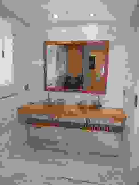 Casa en San Isidro reforma interior Baños modernos de Fainzilber Arqts. Moderno
