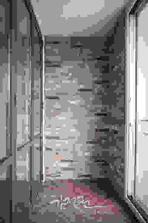 한빛 아파트: 김정권디자이너의  다이닝 룸,모던 벽돌