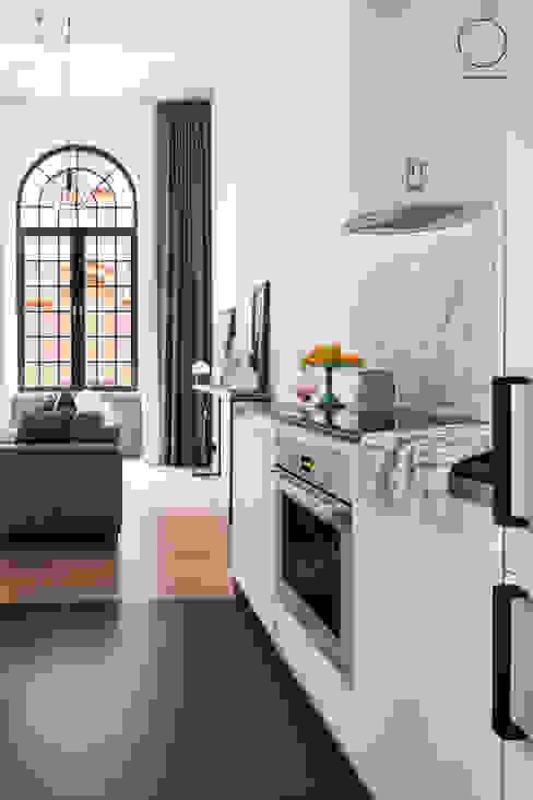 Loft w Łodzi : styl , w kategorii Kuchnia zaprojektowany przez OIKOI,Industrialny