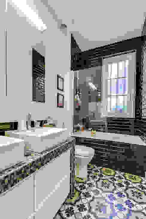 Paris 9 Salle de bain classique par blackStones Classique