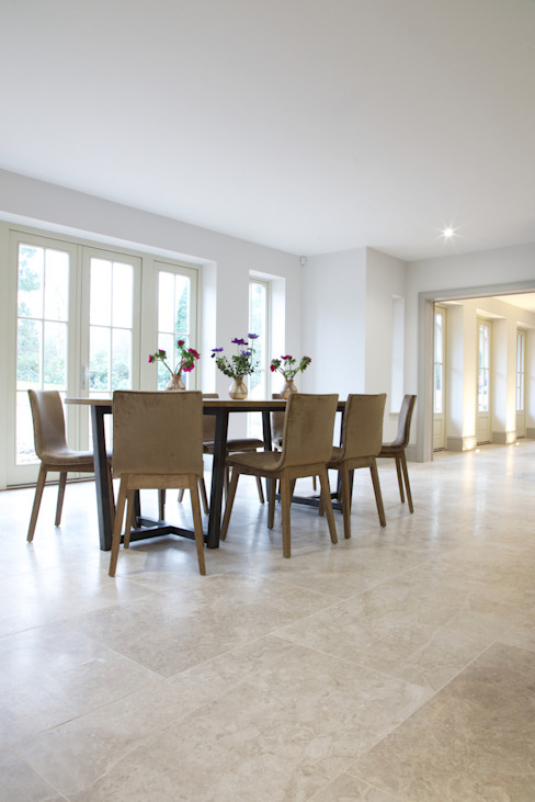 Zofia limestone floor in a honed finish from Artisans of Devizes. Modern dining room by Artisans of Devizes Modern Limestone