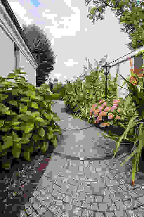 Jardin classique par Gzowska&Ossowska Pracownie Architektury Wnętrz Classique