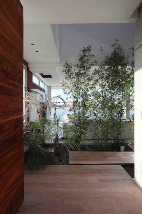Jardines de invierno de estilo moderno de Remy Arquitectos Moderno
