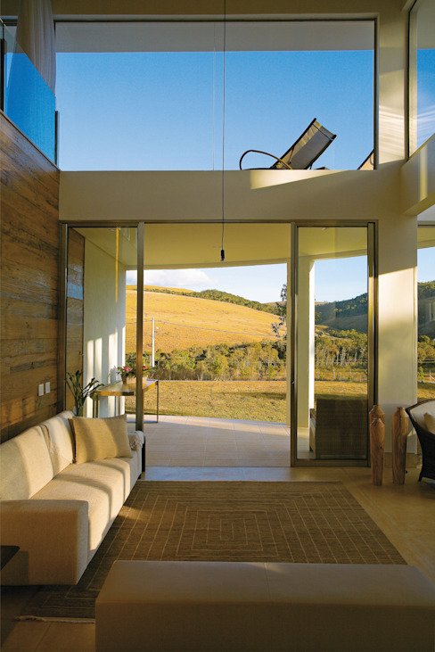 Moderne woonkamers van Isabela Canaan Arquitetos e Associados Modern
