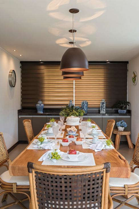 Modern dining room by Bellini Arquitetura e Design Modern