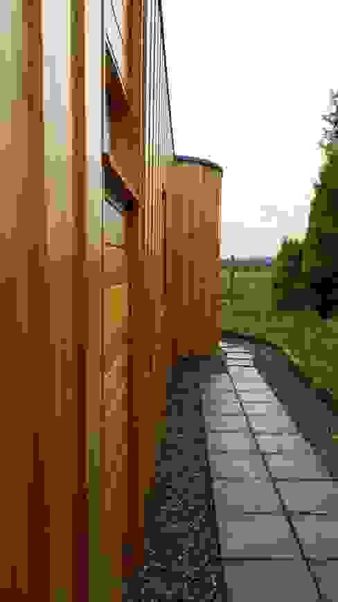 Дома в . Автор – Architects Scotland Ltd, Модерн Дерево Эффект древесины