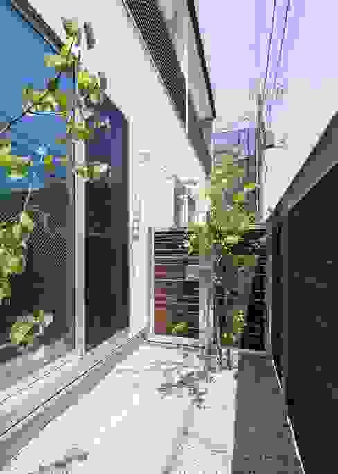 賃貸専用庭: Unico design一級建築士事務所が手掛けたテラス・ベランダです。,オリジナル