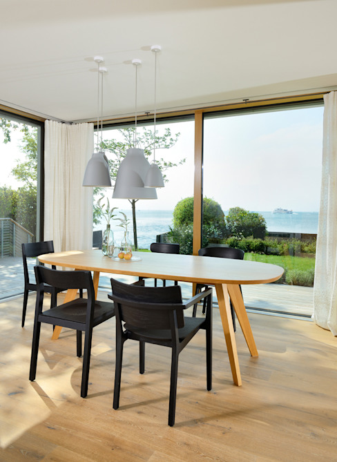 Dining room by Bau-Fritz GmbH & Co. KG,