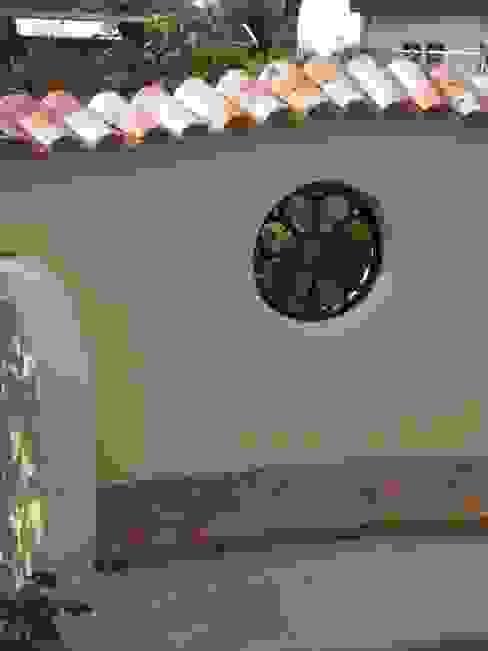 Сад в рустикальном стиле от Rimini Baustoffe GmbH Рустикальный Железо / Сталь
