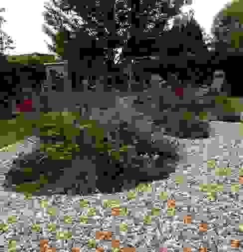 Planted beds de Cornus Garden Design Moderno