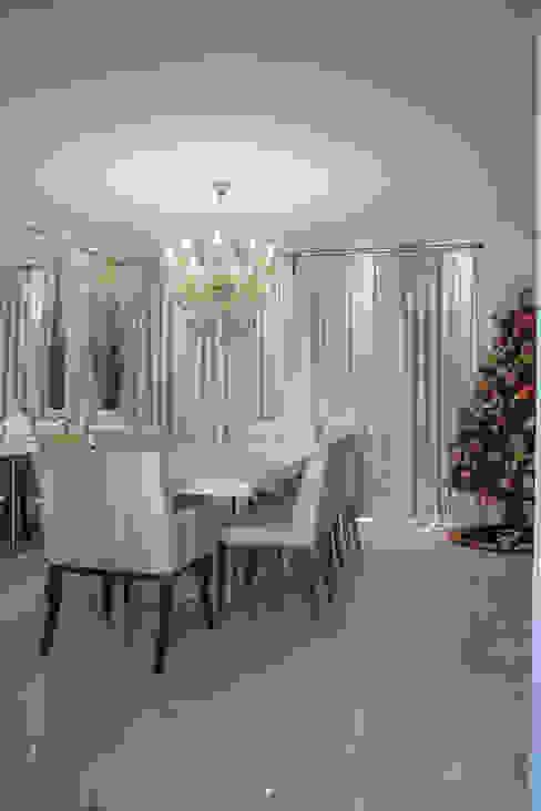 Classic style dining room by Livia Martins Arquitetura e Interiores Classic