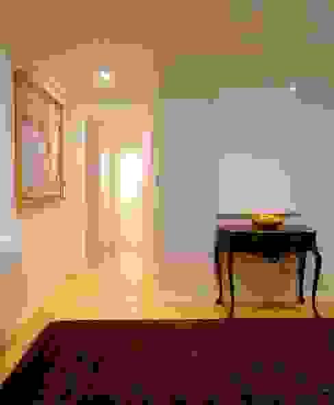 Hall: Corredores e halls de entrada  por armazem de arquitectura
