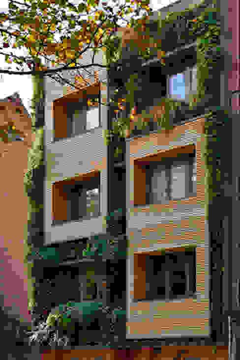immeuble écologique- modulable et recyclée(projet pouvant être évolutif selon la situation futur)-très basse énergie Maisons originales par atelier espace architectural marc somers Éclectique