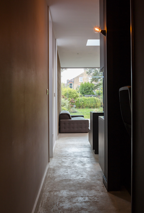View from front door through to garden industrial style corridor, hallway & stairs by Mustard Architects Industrial