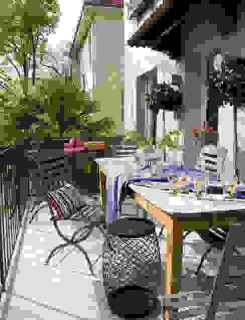 Duplex familiar Balcones y terrazas de estilo ecléctico de Estudio de Arquitectura Teresa Sapey Ecléctico