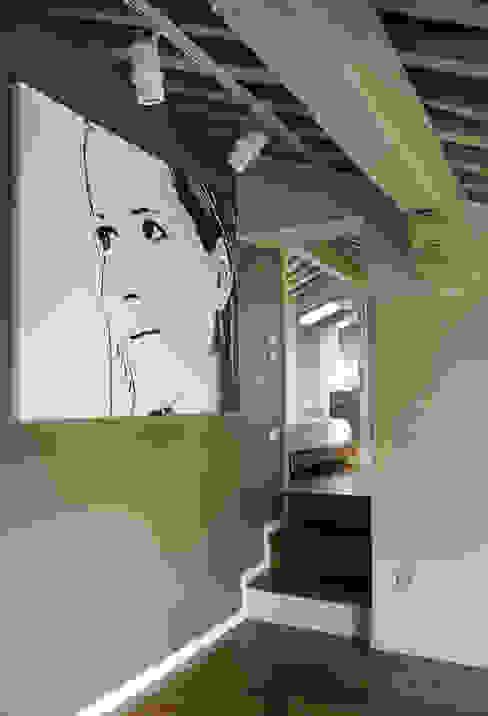 ATTICO #1 cristina mecatti interior design Camera da letto moderna