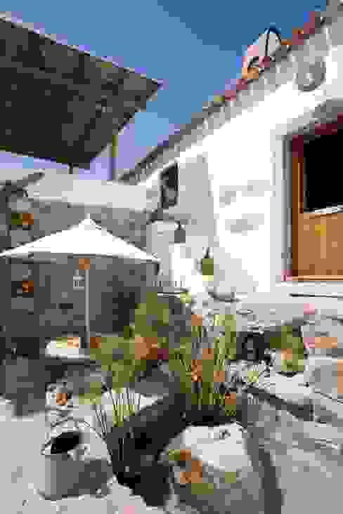 Casas de estilo rústico de pedro quintela studio Rústico Piedra