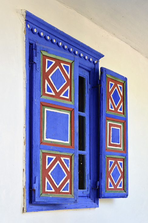Colourful window shutters:  Windows & doors  by London Window Cleaning