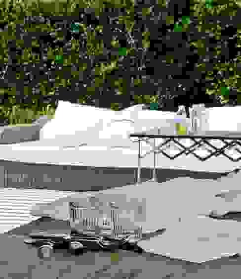 Jardines de estilo  por Arq. PAULA de ELIA & Asociados, Moderno