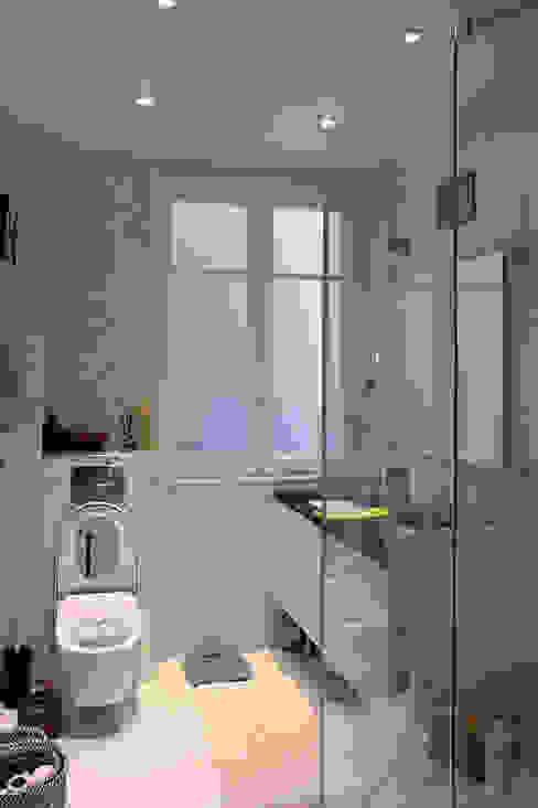 Rénovation d'un appartement haussmannien à Paris Salle de bain classique par Olivier Stadler Architecte Classique