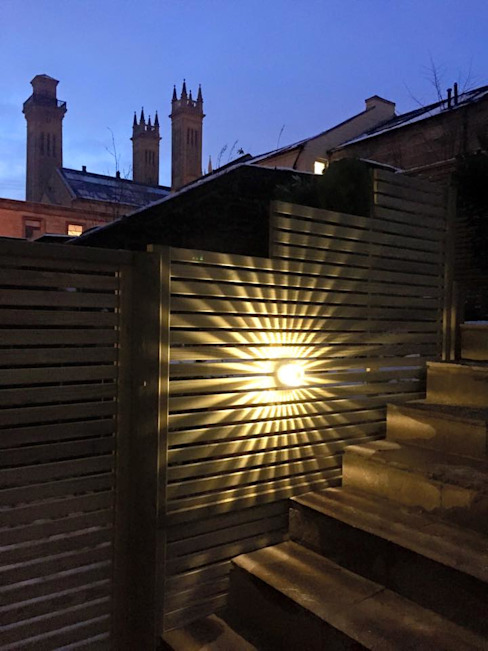 Light on the fence : modern  by Anne Macfie Garden Design, Modern Aluminium/Zinc